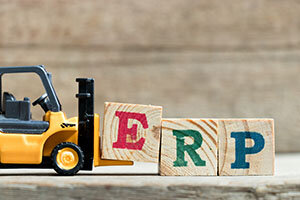 Toy yellow forklift hold letter block E to complete word ERP (Ab